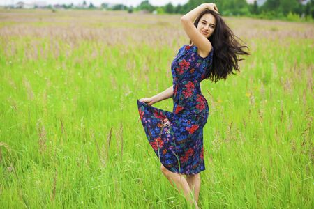 Close up portrait of beautiful young happy brunette woman dress, summer park outdoors