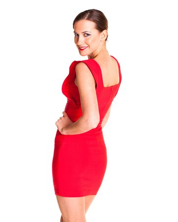 Sexy young brunette woman in evening red dress, isolated on white background