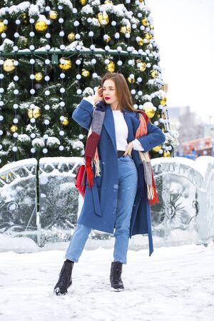 Full-length portrait of young girl walking in a winter park