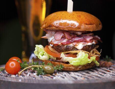 Fast food closeup with traditional tasty hamburger Banco de Imagens