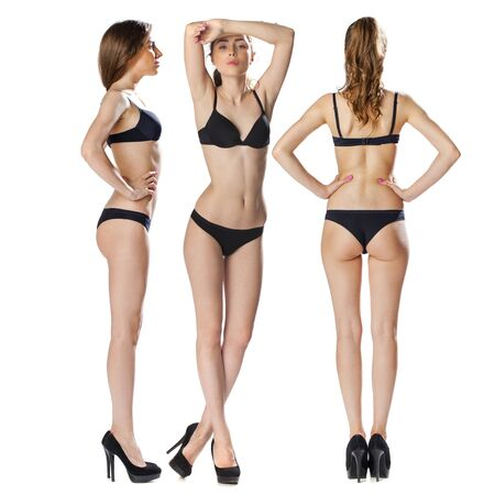 Snap Models. Full length portrait of a beautiful brunette woman in black bikini isolated on white background Imagens