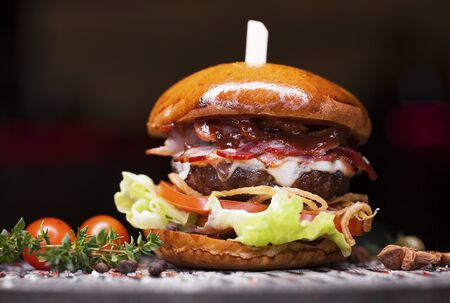 Fast food closeup with traditional tasty hamburger Stock fotó