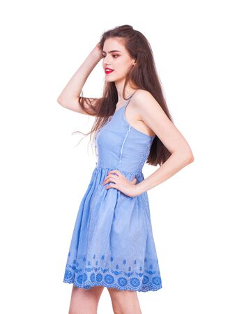 Close up portrait of a young beautiful happy brunette woman in blue dress, isolated on white background Stok Fotoğraf