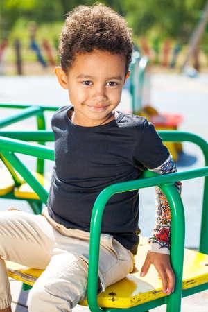 Close up portrait of little boy in autumn park Imagens