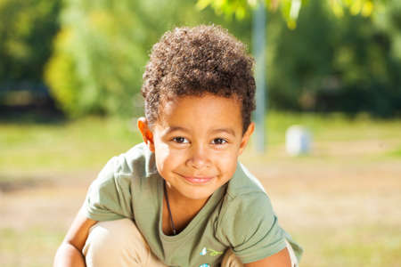Close up portrait of little boy in autumn park