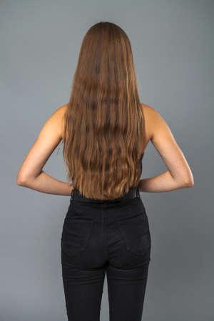 Back rear view brunette hair model, indoor Imagens