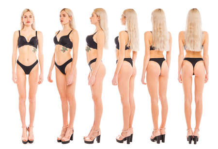 Full body portrait of a young beautiful blonde models posing on a background white isolated Stock Photo