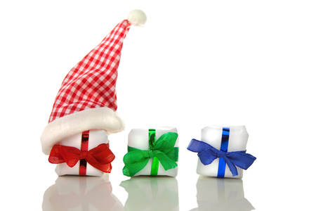 packets: Three white christmas packets with coloured bows and chequered santa hat in front of white background
