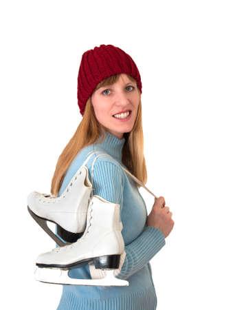 iceskates: happy girl prepared for ice skating in front of white backdrop