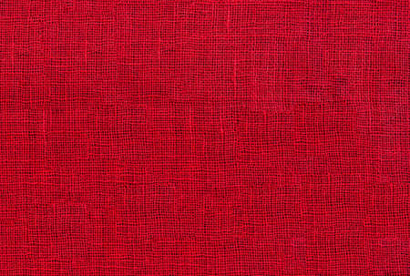 red raw organic fabric sackcloth canvas woven textile backdrop Stock Photo