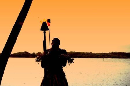 Fiji ceremony. Torch lighting banging of drums cannibal ritual  photo