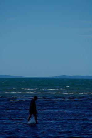 sad Walking on water man photo
