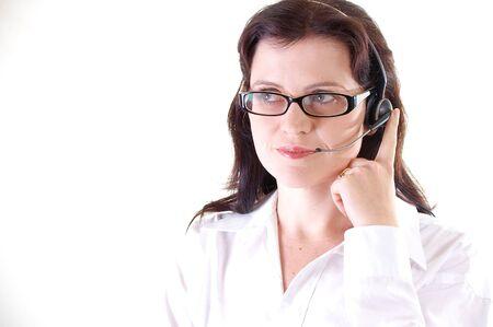 smiling friendly female Customer service telephone  operator photo
