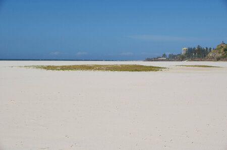 coolangatta: Sandy beach background blue sky ocean Stock Photo