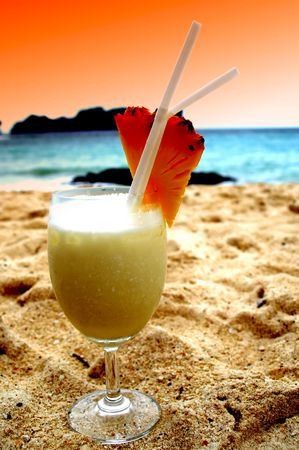 Paradise dreaming with pina colada cocktails at sunset photo