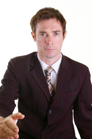 Business man in pinstripped suit giving handshake gesture Stock Photo - 4765048