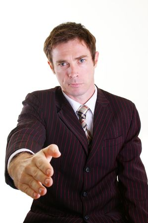 Business man in pinstripped suit giving handshake gesture Stock Photo - 4765049