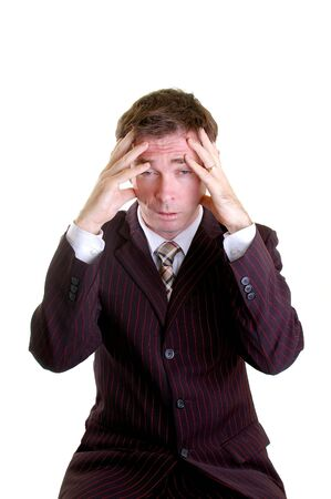 business man with hands on head stressed out photo