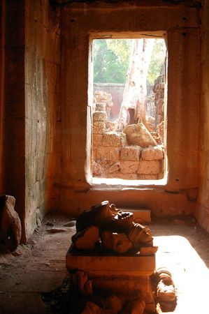 doorway to cambodia jungle from ancient temple photo