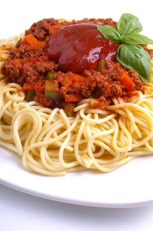 Minced meat spaghetti Bolognese with  chunky vegetables and tomato sauce  photo