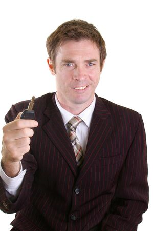 car salesman holding key ready for hand over photo