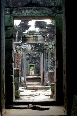 green rubble walk with sun coming through the chamber roof angkor wat  photo