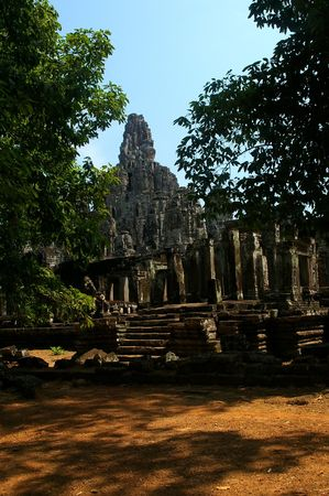 thom: bayon temple through the trees angkor cambodia Stock Photo
