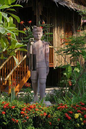 traditonal water boy sculpture in cambodian garden photo