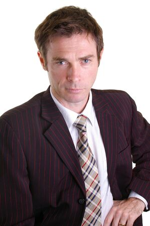 confident looking business man leaning in with jacket open Stock Photo - 5002202