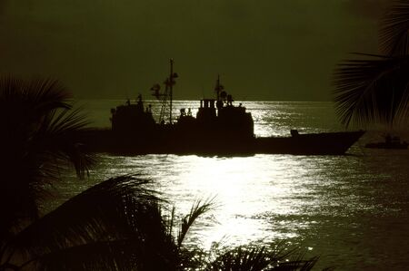 warship navy boat silhouetted in night sky Stock Photo - 5030908