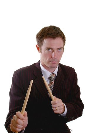 drumming: business man drumming up sales with a drumstick roll Stock Photo