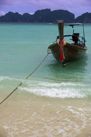longtail: traditional longtail boats on the andaman sea thailand phuket