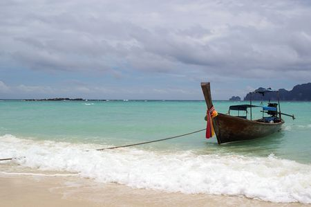 traditional longtail boat on the andaman sea thailand phuket photo