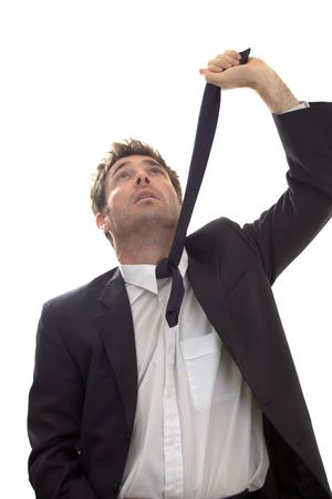 business contemplating suicide by hanging with necktie looking for rafter Stock Photo - 5137417