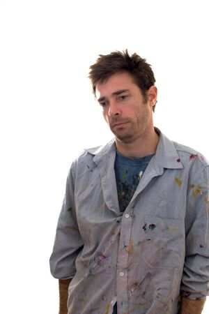 Paint covered home handy man contemplating decorating ideas looking depressed Stock Photo - 5140566