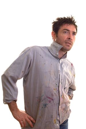 Paint covered home handy man contemplating decorating ideas  Stock Photo - 5143097