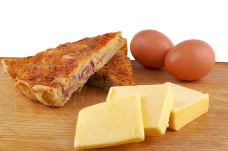 quiche lorraine with eggs and butter on board photo
