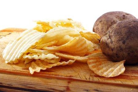 crisps or chips and potatoes on board Stock Photo - 5323703