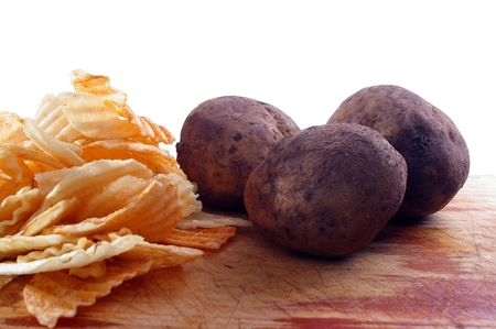 crisps or chips and potatoes on board Stock Photo - 5323702