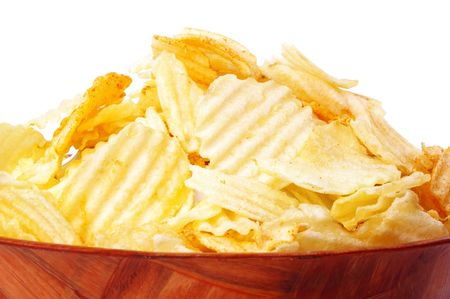 heap of golden chips in wooden bowl  Stock Photo - 5323701