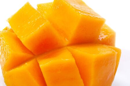 scored: close up of mango scored and spread apart Stock Photo