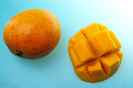 cubed: mango on board with cubed half aswell Stock Photo