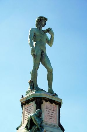 replica bronze statue of david atop of hill overlooking florence  photo