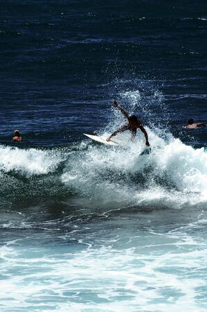 shorebreak: Surfer riding a wave on the famous water of the gold coast australia