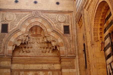 Intricate carving of Islamic cario mosque doorway photo