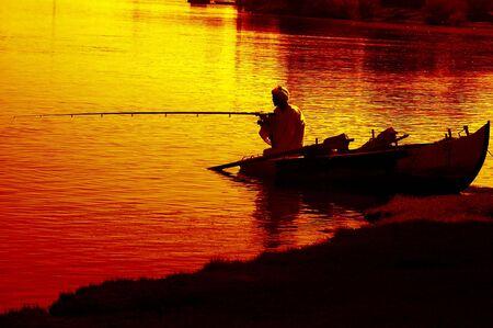 traditional muslim village fisherman on the nile in aswan eygpt  photo