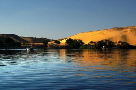 Very scenic background of boat going down Nile in aswan Stock Photo - 5911156