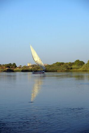Felucca saling down the nile aswan egypt Stock Photo - 5911171