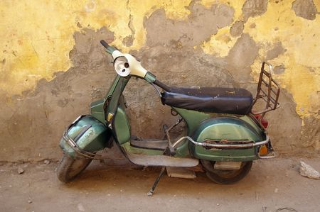 italy culture: moped classic looking travel background reminiscent of anywhere in Europe