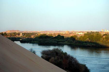 Overlooking the tourist town of aswan from outskirts sand bank on nile